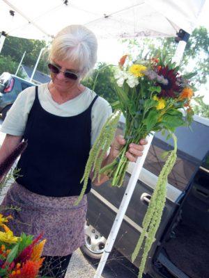 Linda Chapman selling flowers