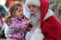 Santa holding a young girl