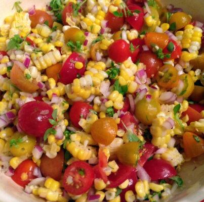 salad of corn, onions, tomatoes, herbs