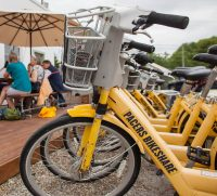yellow bikes parked near outdoor dining