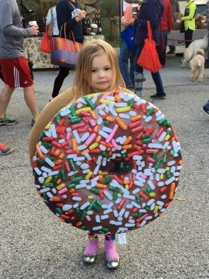 little girl in a donut costume