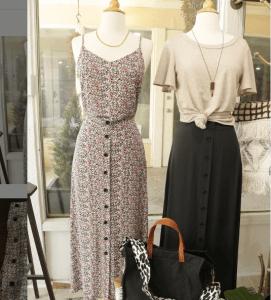 Dress, shirt, and skirt on display